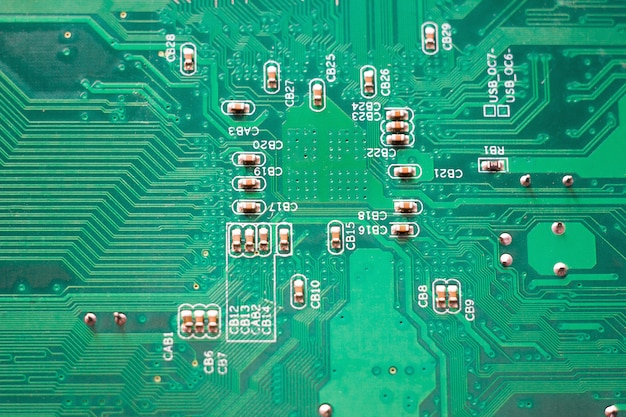 Close-up microcircuit, green pc motherboard, modern technologies