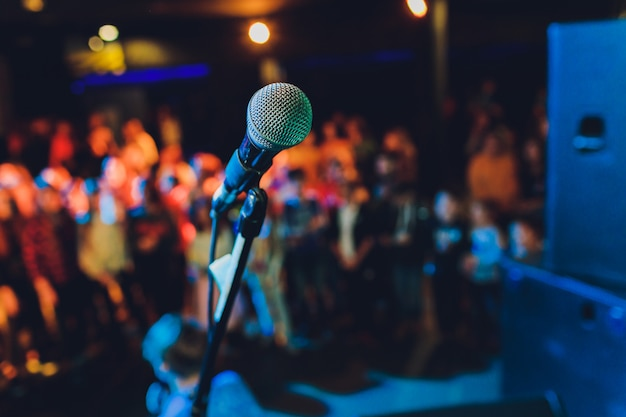 Close up of microphone in concert hall or conference room.