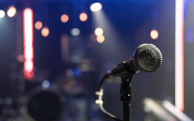 Close up of a microphone on a concert stage with beautiful lighting.