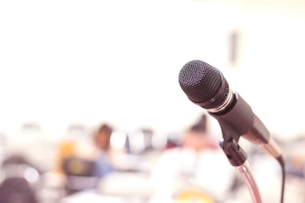 Close up microphone in conference on seminar room event background