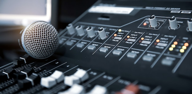 Close-up microphone on sound mixer equipment for recording