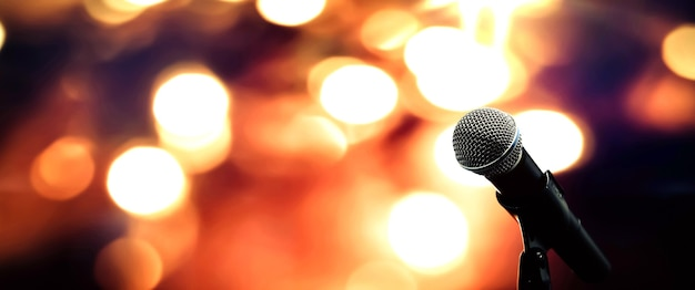 Close-up the microphone on stand with blur background.