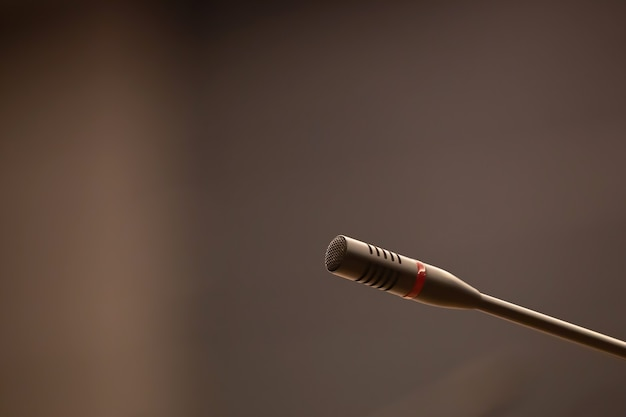 Close-up the microphone with blur background.