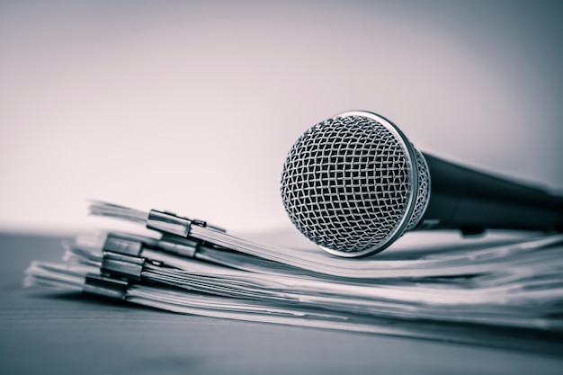 Close up a microphone with paper document
