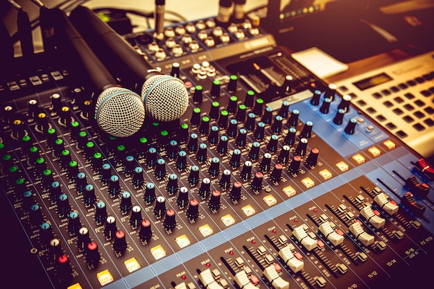 Close up microphones and audio mixer in studio