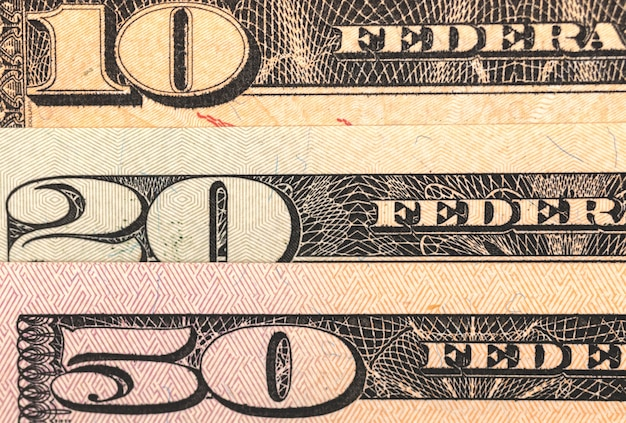 Close-up to middle denomination us dollar banknotes, 10, 20 and 50 denominaton photo