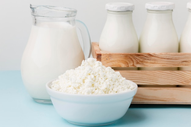 Close-up milk jug with fresh cottage cheese