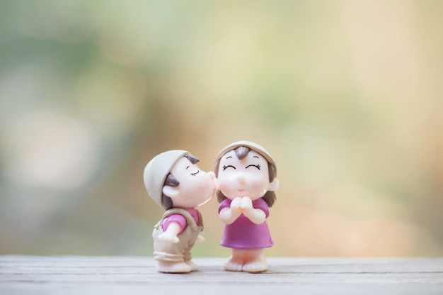 Close up of mini couple dolls in romantic kiss