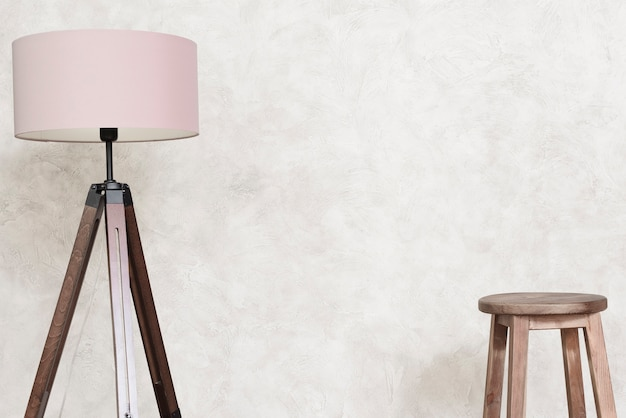 Close-up minimalist designer floor lamp and bar stool