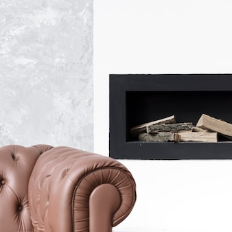Close-up minimalist fireplace  and sofa