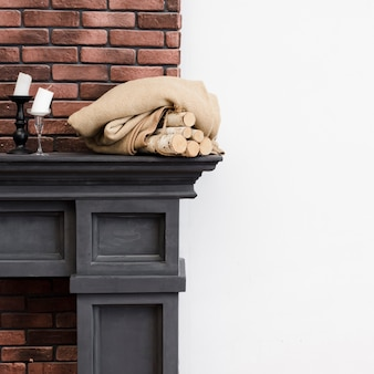 Close-up minimalist fireplace with brick wall