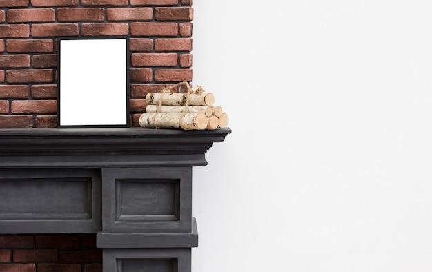 Close-up minimalist fireplace with brick wall