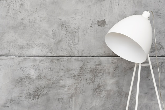 Close-up minimalist white floor lamp with concrete panels