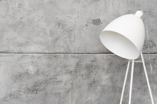 Close-up minimalist white floor lamp with concrete panels