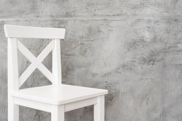 Close-up minimalist white stool with concrete panels