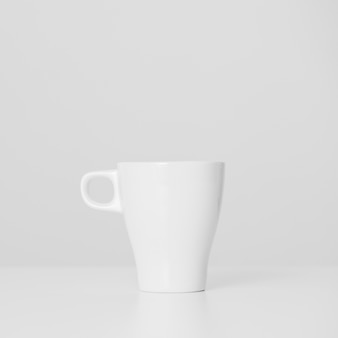 Close-up minimalistic white cup