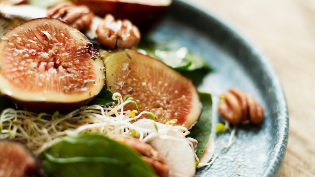 Close up mix of nuts and figs on plate