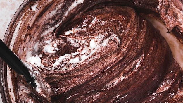 Close-up of mixed chocolate cake dough in bowl