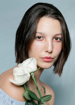 Close up model holding a flower