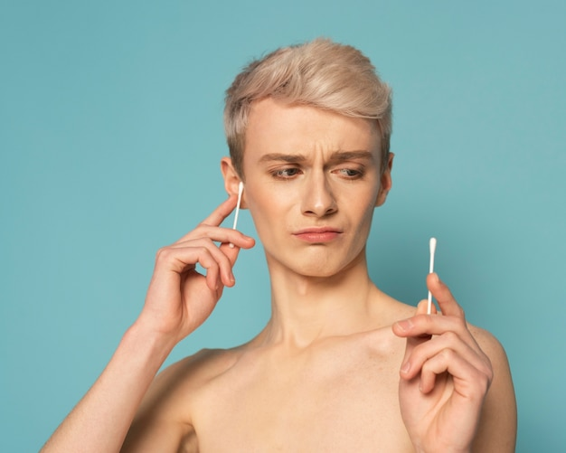 Close up model holding swabs