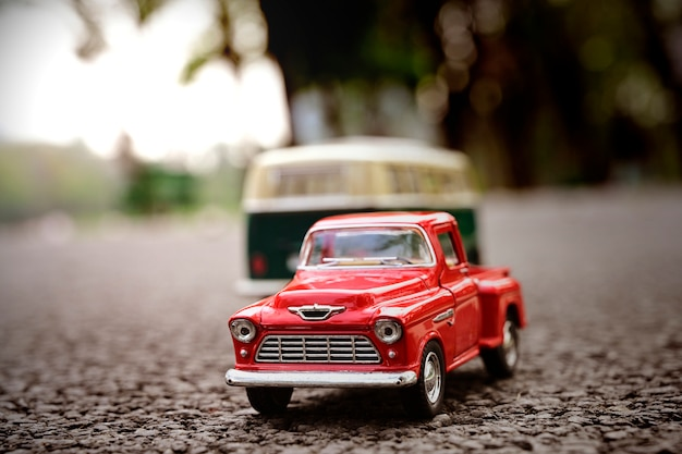 Close-up model pickup and van toy transport on the road