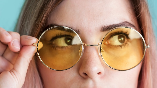 Close up model with yellow glasses