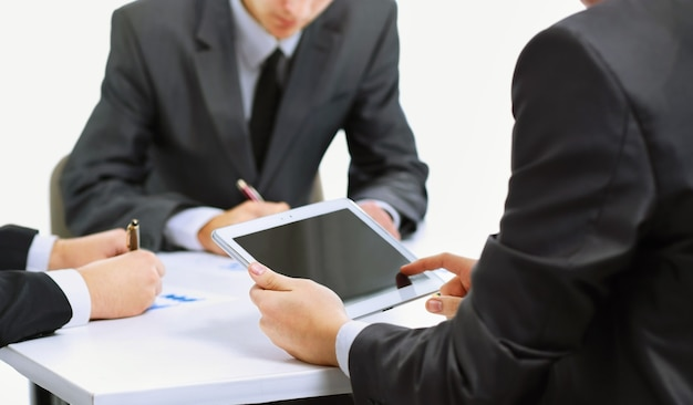 Close-up of a modern business team using tablet computer to work