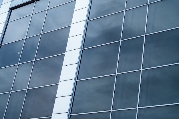 Close-up of a modern glass building with square blue glass