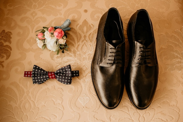 Close up of modern groom accessories
