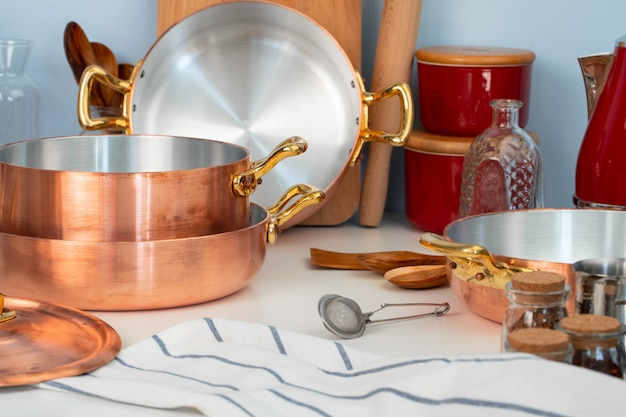 Close up of modern kitchen interior with copper cookware