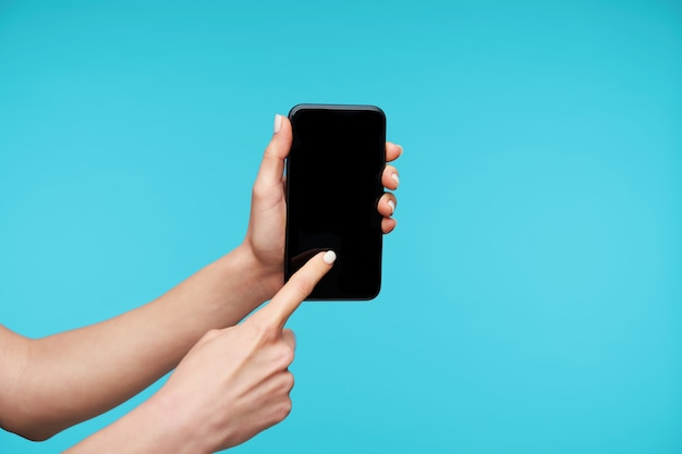Close up on modern smartphone being kept by hands