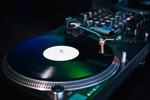 Close-up of modern turntable vinyl record player with music plate