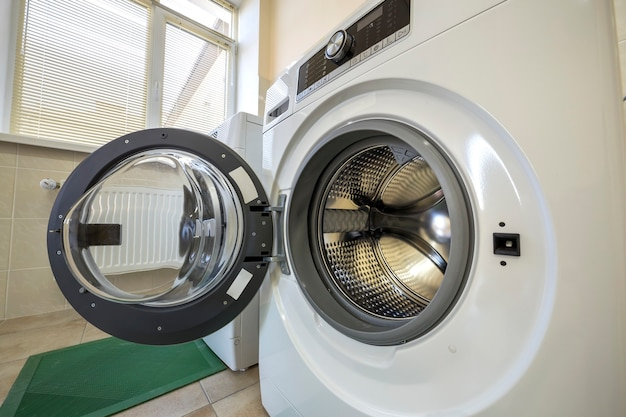 Close-up of modern washing machine with open door