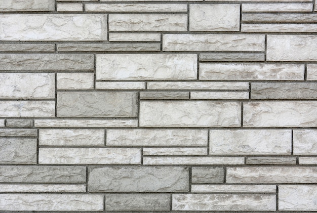 Close up modern white and gray color stone wall texture for background