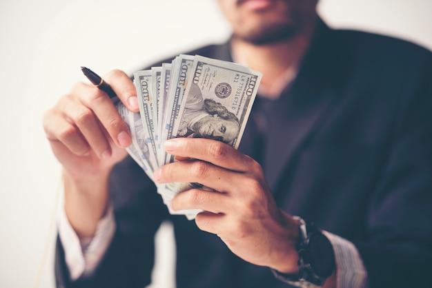 Close up money us dollar bills in hand