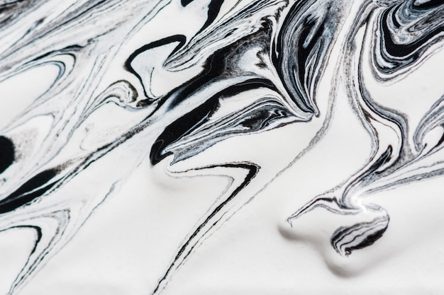 Close-up of monochrome paint swirls