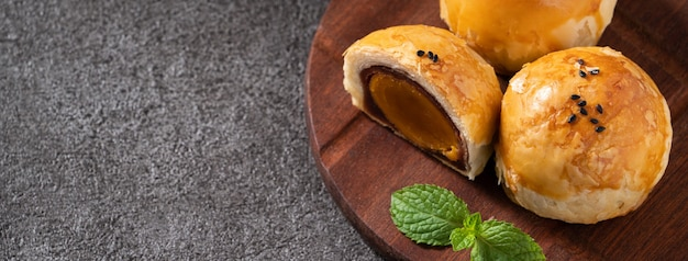 Close up of moon cake yolk pastry, mooncake for mid-autumn festival holiday on dark gray table background