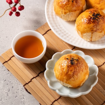 Close up of moon cake yolk pastry, mooncake for mid-autumn festival holiday on gray table background