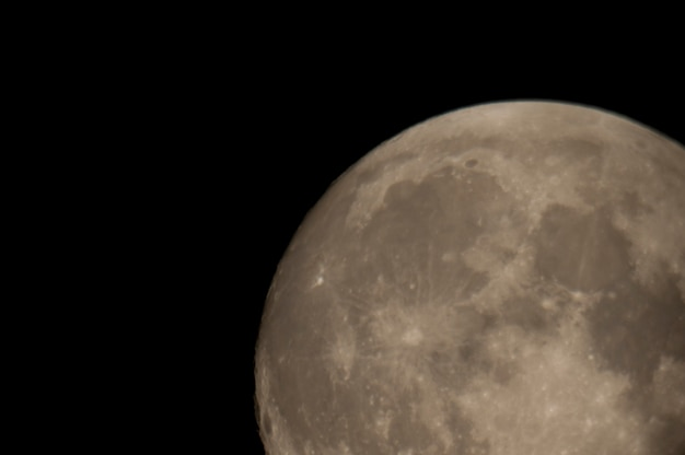 Close up of the moon in the night sky over lake of the woods, ontario