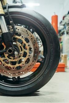Close up of motorbike wheel in a garage
