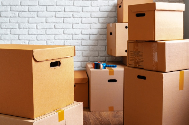 Close up of moving carton boxes in an empty room