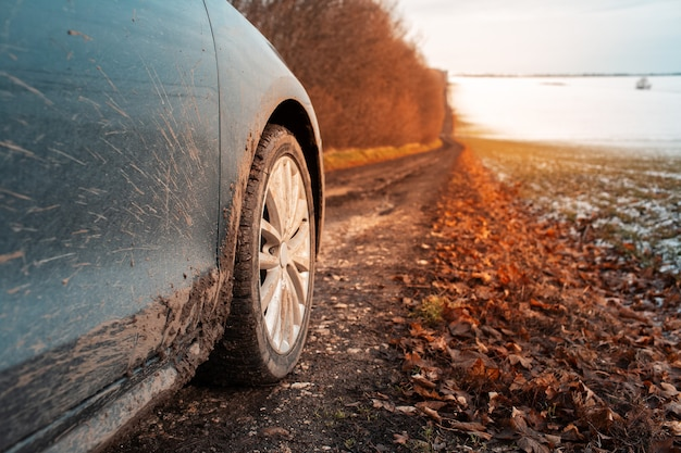 Close-up of muddy wheel of car on road. offroad driving.
