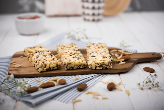 Close-up muesli batons on wooden board