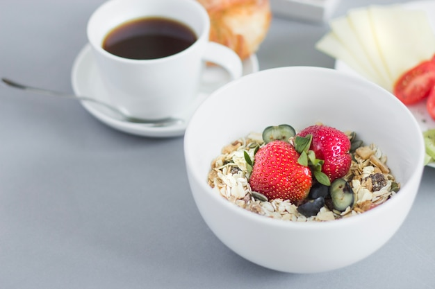Close-up of muesli bowl and breakfast plates