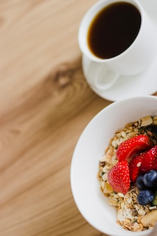 Close-up of muesli bowl and coffee