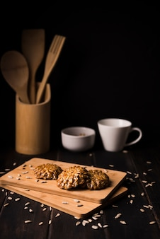 Close-up muesli cookies on wooden board