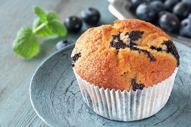 Close-up on muffin with blueberries on gray rustic background