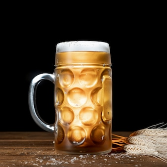 Close-up mug of beer with black background