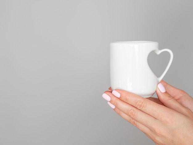 Close up mug with heart handle