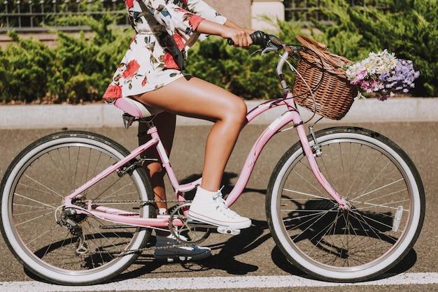 Close up. mulatto girls leg on the bike pedal